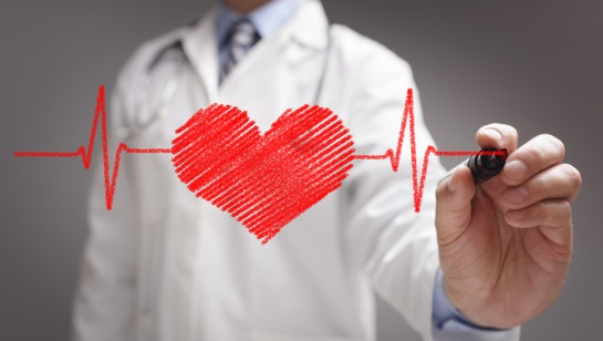 A Functional Medicine Doctor Westmont IL drawing a heartbeat line with a heart inside of it