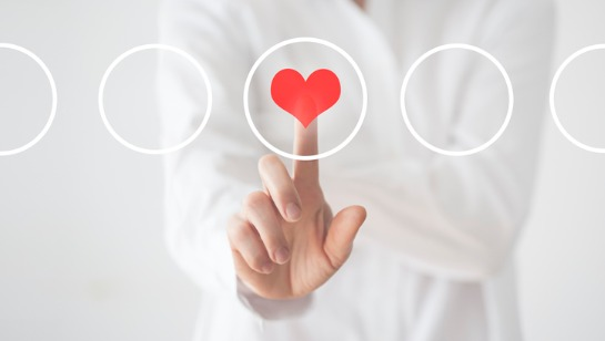 A Functional Medicine Doctor in Downers Grove IL pressing a button with a heart in it