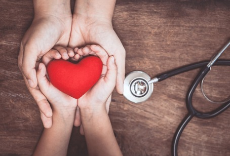 Hands holding a heart, representing Integrative Medicine Clarendon Hills IL
