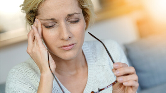 Woman suffering migraine in need of Migraine Specialist in Downers Grove IL