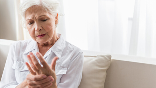 Elderly woman holding hand requiring Natural remedies for joint pain relief in Clarendon Hills IL